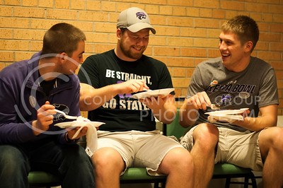 (from left) Christian Maude, junior secondary education, Josh Liebe, junior business management and Dakota Spencer, junior in accounting, enjoy pancakes and socializing at the FarmHouse pancake feed on the night of Monday, Jan. 28, 2013.  Hannah Hunsinger / Collegian
