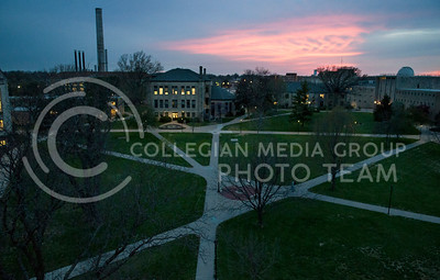 (Hannah Hunsinger | Collegian)  The sunset turns the sky a firey pink over the quad on the evening on April 25, 2013.