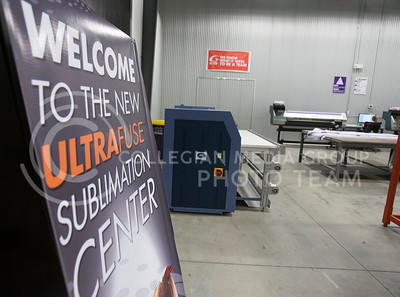 A sign welcomes visitors and employees to the new sublimation center in GTM Wednesday afternoon. The area incorporates a new way of printing and designing jerseys and appareal for sport teams or other clubs.  (Photo by Evert Nelson/Collegian)
