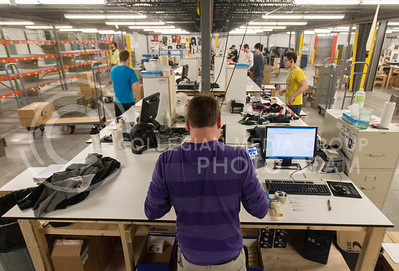 Employees work on various stages of appareal production at the GTM factory Wednesday afternoon. GTM recently opened a new section in their factory for designing and producting jerseys and sport apparel.  (Photo by Evert Nelson/Collegian)