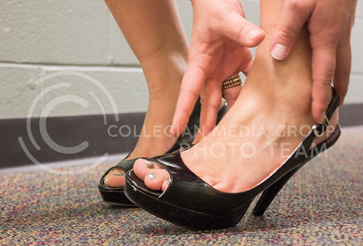 (Photo by Kate Hagans | Collegian) By wearing unhealthy shoes, your feet are affected in painful physical way.
