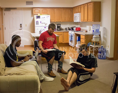 (Photo by Kate Hagans | Collegian) Victor Roy, a freshmen in Pre-Journalism and Mass Communications, Lucas Ellis, a freshman in Feed science, and Chad Hall a freshman in Environmental Design, study together in their living room appartment located in Jardine Appartments on Feb 20. Kansas State University's Department of Housing and Dining Services provides residence hall living for approximately 528 appartments for students and their families.