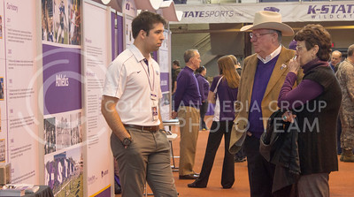 (Photo by Kate Hagans | Collegian) Dan Bird, Kansas State alumi and Beth Bird, Kansas State alum, both consult with Joe Rush about the Kansas State athletics at Ahernfield house on Feb 14. Dan Bird and Beth Bird reclently moved to Manhattan Kansas a little over a year ago.