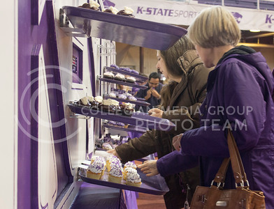 (Photo by Kate Hagans | Collegian) Judy Weaver, agriculture staff at Kansas State and Christina Nash, agriculture staff at Kansas State, both help themselves to the free cupcakes provided at the 150 kick off celebration in Ahernfield House on Feb. 14.