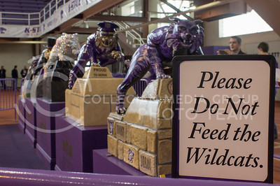 (Photo by Kate Hagans | Collegian) Five wildcat statues are being featured for the 150th birthday of Kansas State in the Ahearn Fieldhouse on Feb. 14. This was the kick off for first day of many more 150th celebration events to come.