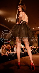 (Photo by Parker Robb | Collegian)  A K-State student model displays the dress designed by Samantha Caresio, senior in apparel and textile design, as she walks down the runway at K-State Project Runway, Season Four, held February 15 at the K-State Student Union. Student fashion designers participating in the show were challenged to create their own designs out of a vintage wedding dress.