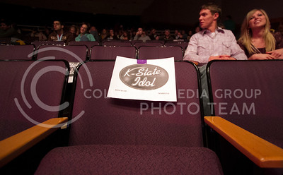 A seat in Forum Hall remains researved for K-State Idol contestants during season ten of the UPC event. K-State Idol was Monday from 8 to 10.  (Photo by Evert Nelson/Collegian)