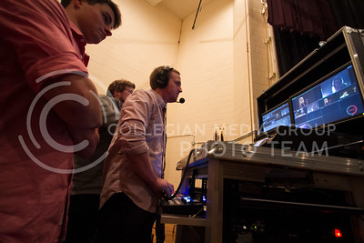 Brian Broeckelman, (left) senior in JMC, Christian Young, DMC member, and Dillon Hayes, senior in JMC, opporate the video behind the scenes of K-State Idol Monday in Forum Hall of the Union.  (Photo by Evert Nelson/Collegian)