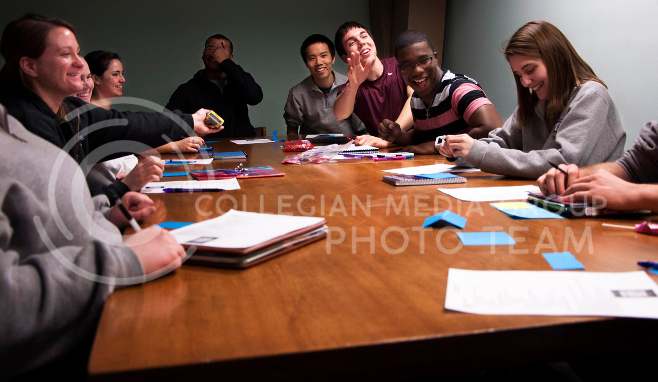 (Photo by Hannah Hunsinger   Collegian)<br /> <br /> Hill, second from right, and the other West Hall RAs joke during the beginning of a staff meeting in the basement of West Hall on April 1, 2013.  The RAs meet once a week with their staff leader to discuss the all things West Hall.
