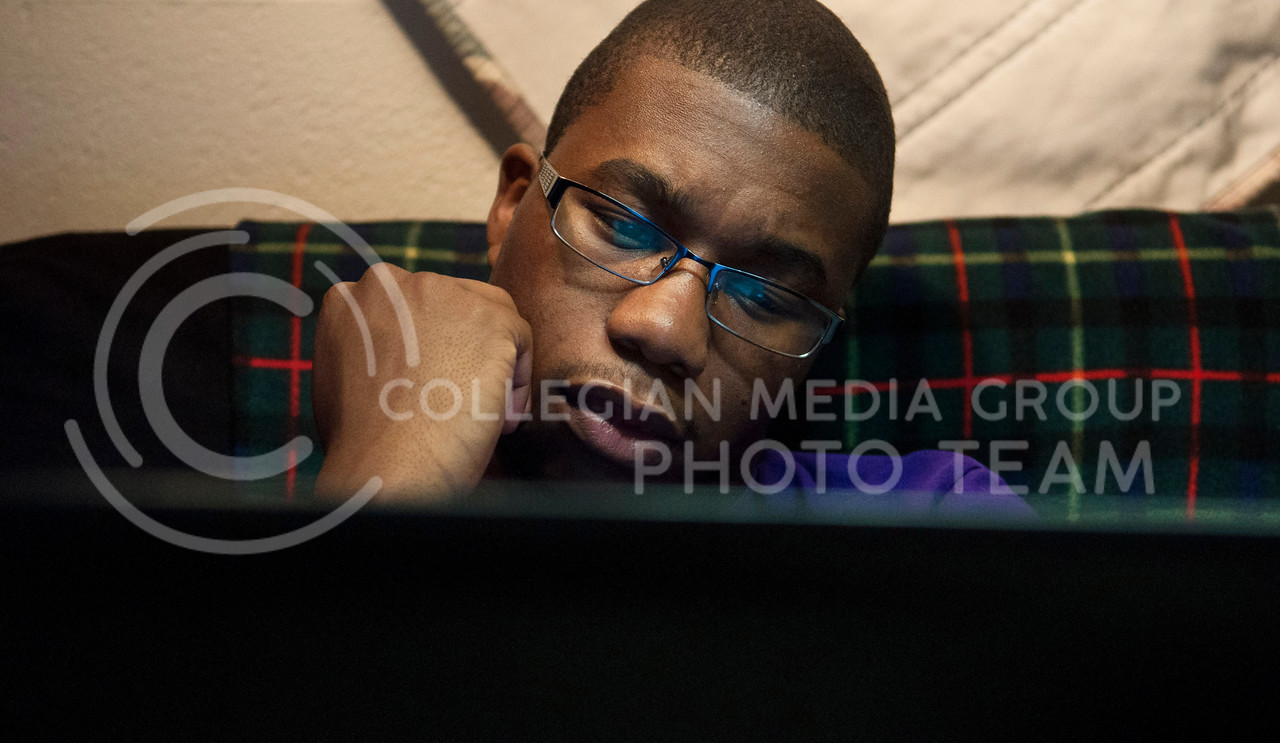(Photo by Hannah Hunsinger   Collegian)<br /> <br /> On April 11, 2013, Hill studies in his room on the first floor of West Hall. RAs have to balance the responsibilities of their jobs with pressures of keeping up with school work.
