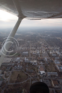 From the wings of a small Cessna plane, Kansas State's campus shines through the foggy air Feb. 8, 2013.  (Photo by Evert Nelson/Collegian)