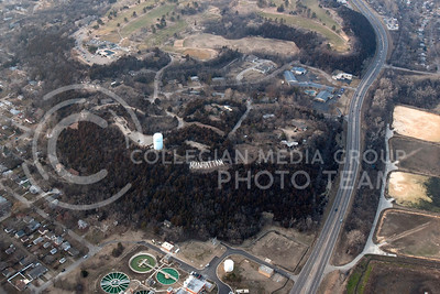"""Bluemont Hill from above shows the familiar """"MANHATTAN"""" cement letters as well as Manhattan Country Club.   (Photo by Evert Nelson/Collegian)"""