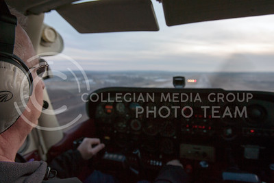Looking for specific lights out of the four on the runway to turn red, Ron (BLANK) guides the small Cessna airplane in for a landing Friday Feburary 8, 2013 at Manhattan Municipal Airplanes.  (Photo by Evert Nelson/Collegian)