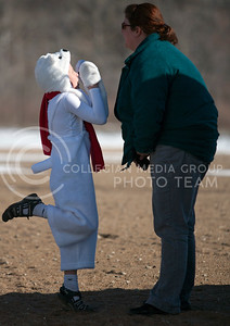 Being a playful polar bear, Connor Hazel (left), shares a moment with his momma bear Christa Hazel, both Manhattan residents at the Polar Plunge at Tuttle Creek swim beach Saturday. This is Connor, 9 years old, second polar plunge event he has been a part of. He won the individual costume contest at the Polar Plunge event.  (Photo by Evert Nelson/Collegian)