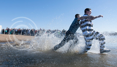 A runaway convict is taken down by a police officer during Polar Plunge event at Tuttle Creek swim beach Saturday afternoon. Both the officer and convict were uninjured and were just students in costume.  (Photo by Evert Nelson/Collegian)