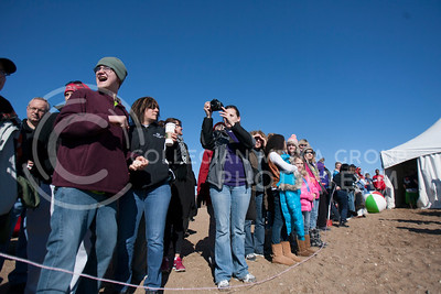 Crowds of people line the runway into the icy water at Tuttle Creek swim beach during the Polar Plung event Satuday afternoon.  (Photo by Evert Nelson/Collegian)