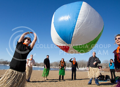 The staff of Texas Roadhouse bounce a giant beach ball around before the Polar Plunge event at Tuttle Creek swim beach began last Saturday. As well as being a charity event, teams and individuals can dress up to compete in the costume contest before the plunge begins. The Texas Road House group won the team award for best costume.  (Photo by Evert Nelson/Collegian)