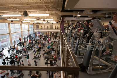 People work out downstairs in the weight area while more use cardio machines upstairs. The work out areas are part of the new addition to the Rec Center which opened Tuesday.  (Photo by Evert Nelson / Collegian)