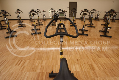 Multiple biking machines sit in a new studio in the Rec Center waiting to be used. Tuesday marked the first day the new additions were opened.  (Photo by Evert Nelson / Collegian)