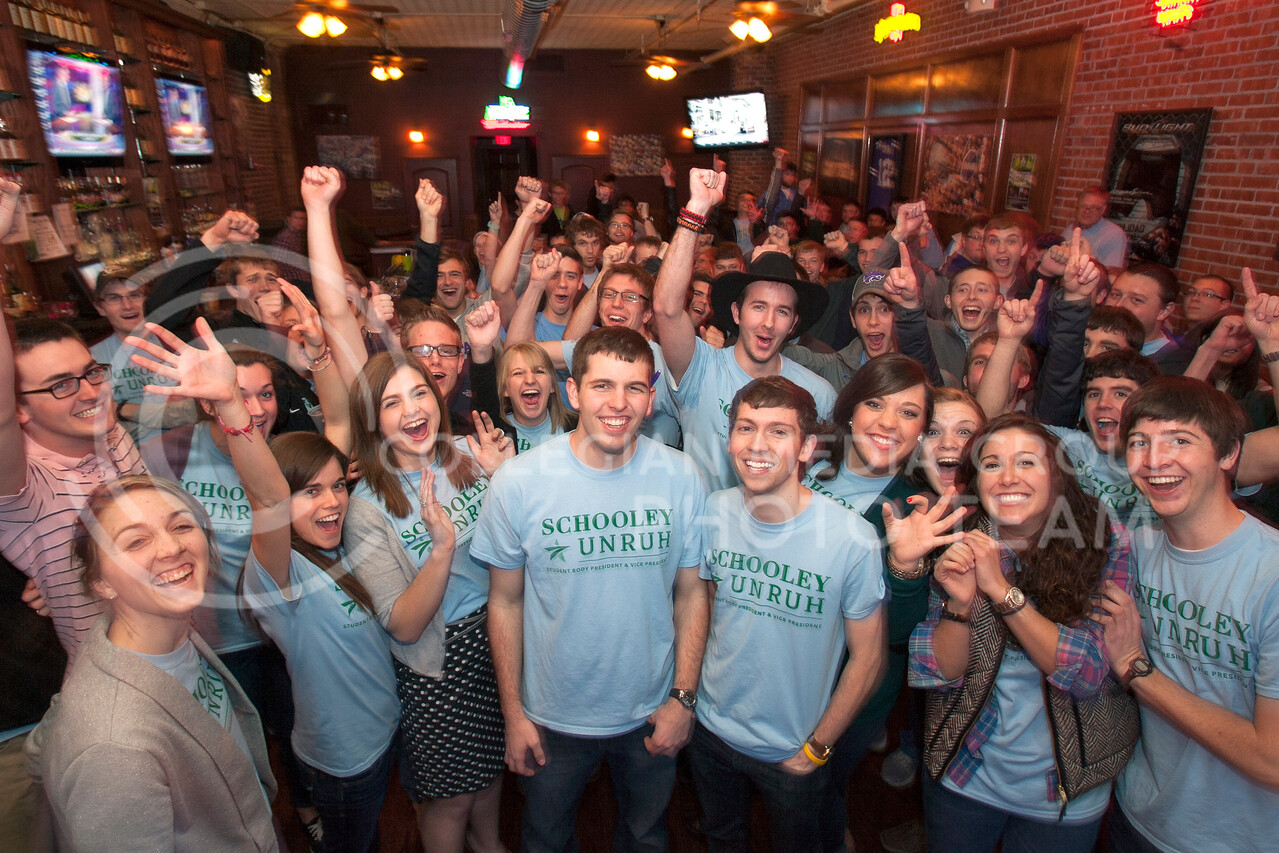 Eli Schooley and Jake Unruh stand in front of supporters in Johnny Kaw's shortly after hearing the news of their victory in the SGA elections Wednesday night.<br /> <br /> (Photo by Evert Nelson | Collegian)