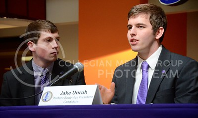 (Photo by Parker Robb | Collegian)  Student Body Vice Presidential candidate Jake Unruh answers questions from the audience as his running mate Eli Schooley looks on during the candidate debate held in the K-State Student Union courtyard February 19.
