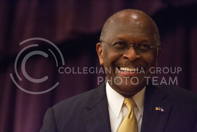 Herman Cain laughts after someones questions during his event at the Union Grand Ballroom Tuesday night.   (Photo by Evert Nelson/Collegian)