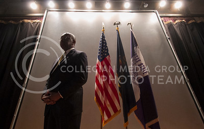 After taking questions from the audience, Herman Cain walked behind the stage to a backdrop with flags to be asked questions from the media. Cain spoke at an event put on by Young American's Tuesday in the Grand Ballroom of the Union.  (Photo by Evert Nelson/Collegian)