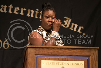 Sybrina Fulton, mother of Trayvon Martin, wipes away tears while speaking about her son's death.  Fulton spoke about gun violence and the Stand Your Ground Law at Kansas State University in Manhattan, KS on April 22, 2014.