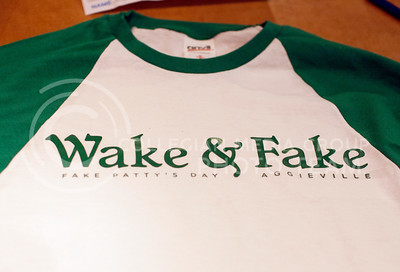 "A finished shirt with the words ""Wake & Fake Fake Patty's Day Aggieville"" lays on a table in the back of Threads Wednesday night.  (Photo by Evert Nelson 
