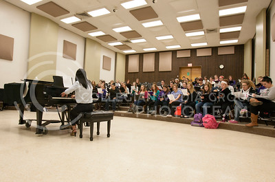 "The womens choir class practices in McCain Auditorium 204 Tuesday afternoon from 2:30-3:20. Conductor Julie Yu plays the piano as acompany as the girls sing ""Kafal"" a Czech song.  (Photo by Evert Nelson/Collegian)"