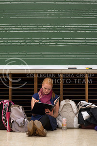 Laurel Burton, freshman studying music education, sits by the chalk board in the front of the room whie the womens choir class practices in front of her. The class practiced Tuesday in McCain 204.  (Photo by Evert Nelson/Collegian)