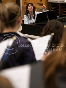 Conductor Julie Yu points out a part to her womens choir class Tuesday in McCain auditorium 204.  (Photo by Evert Nelson/Collegian)