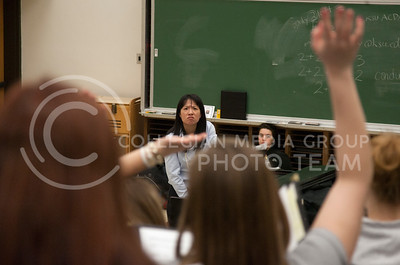 Directing her attention to a section of the choir, conductor Julie Yu answers a question about the piece of music they were practicing Tuesday afternoon. The womens choir class practices in McCain auditorium 204.  (Photo by Evert Nelson/Collegian)