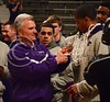 (Parker Robb | Collegian)<br /> <br /> Head Men's Basketball Coach and Big XII Coach of the Year Bruce Weber cuts a strand off the basketball net draped around senior forward Rodney McGruder's neck during the pep rally March 11 at Bramlage Coliseum. The Big XII trophy returns to Manhattan for the first time since 1977.