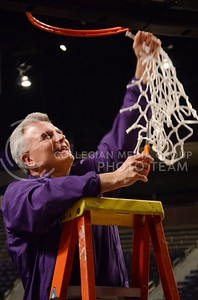 (Parker Robb | Collegian)  Head Men's Basketball Coach and Big XII Coach of the Year Bruce Weber cuts down the net during the pep rally March 11 at Bramlage Coliseum. The Big XII trophy returns to Manhattan for the first time since 1977.