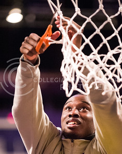 (Photos by: Emily DeShazer | Collegian) Martavious Irving cuts down the net at Bramlage Coliseum on March 11, 2013 after winning a share of the Big 12 championship.