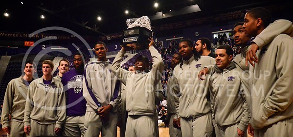 (Parker Robb | Collegian)  The 2013 Big XII Champion Wildcat basketball team displays their newly-won Big XII basketball trophy during the pep rally March 11 at Bramlage Coliseum. The Big XII trophy returns to Manhattan for the first time since 1977.