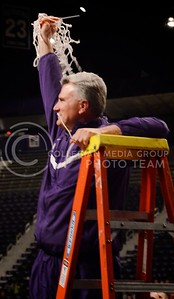 (Parker Robb | Collegian)  Head Men's Basketball Coach and Big XII Coach of the Year Bruce Weber displays the freshly-cut basketball net to a roaring crowd during the pep rally March 11 at Bramlage Coliseum. The Big XII trophy returns to Manhattan for the first time since 1977.