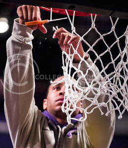 (Photos by: Emily DeShazer | Collegian) Rodney McGruder cuts down the net at Bramlage Coliseum on March 11, 2012 after winning a share of the Big 12 championship.