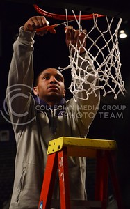 (Parker Robb | Collegian)  Senior forward Rodney McGruder cuts down his portion of the net during the pep rally March 11 at Bramlage Coliseum. The Big XII trophy returns to Manhattan for the first time since 1977.