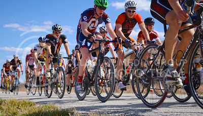 (Photo by Parker Robb | Collegian)  Cyclists whiz across the Flint Hills east of Tuttle Creek Lake during the men's road race April 6, 2013, of the Wildcat Grand Prix, hosted by the K-State Cycling Club. Collegiate cyclists from all across the midwest flocked to Manhattan to compete.