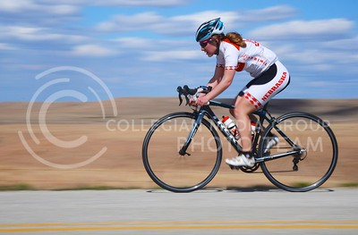 (Photo by Parker Robb | Collegian)  A cyclist from the University of Nebraska races through the Flint Hills east of Tuttle Creek Lake during the women's road race April 6, 2013, of the Wildcat Grand Prix, hosted by the K-State Cycling Club. Collegiate cyclists from all across the midwest flocked to Manhattan to compete.