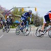 (Photo by Parker Robb | Collegian)<br /> <br /> Cyclists whiz around a corner at 11th and Poyntz Avenue during one of the criterium races of the Tallgrass Classic, held May 5, 2013, on a lap course around City Park. Collegiate and semi-pro cyclists came from many different states to compete in this event, which also included a road race by Tuttle Creek Lake the previous day.