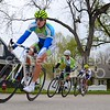 (Photo by Parker Robb | Collegian)<br /> <br /> Cyclists pass in front of houses on 14th Street during one of the criterium races of the Tallgrass Classic, held Sunday on a lap course around City Park. Collegiate and semi-pro cyclists came from many different states to compete in this event, which also included a road race by Tuttle Creek Lake the previous day.