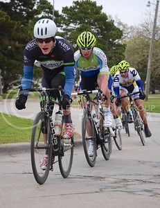 (Photo by Parker Robb   Collegian)  Cyclists weave around several corners in City Park during one of the criterium races of the Tallgrass Classic, held May 5, 2013, on a lap course around City Park. Collegiate and semi-pro cyclists came from many different states to compete in this event, which also included a road race by Tuttle Creek Lake the previous day.