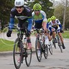 (Photo by Parker Robb | Collegian)<br /> <br /> Cyclists weave around several corners in City Park during one of the criterium races of the Tallgrass Classic, held May 5, 2013, on a lap course around City Park. Collegiate and semi-pro cyclists came from many different states to compete in this event, which also included a road race by Tuttle Creek Lake the previous day.