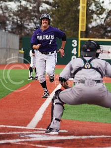 (Photo by Jed Barker | Collegian) Second baseman Ross Kivet, runs in to home base after Shane Conlon hits a double to right field against California Polytechnic at Tointon Family Stadium in Manhattan, Kansas on March 9, 2013.