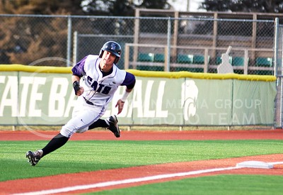 (Photo by Jed Barker | Collegian) Senior outfielder Tanner Witt rounds the corner at third base and head to home plate for K-State's first run of the game against the Nebraska Cornhuskers at Tointon Family Stadium on April 2, 2013. Witt had five hits in the game, setting a new career high.