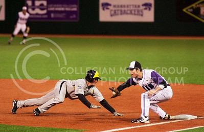 (Photo by Jed Barker | Collegian) Wichita State's Tyler Baker is picked off at first base as K-State's Shane Conlon makes the catch and the tag during the top of the 4th inning at Tointon Family Stadium on Tuesday, April 9, 2013.
