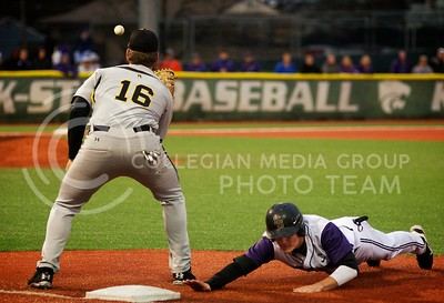 (Photo by Jed Barker | Collegian) Sophomore Shane Conlon dives back toward first base against Wichita State at Tointon Family Stadium on April 9, 2013. The Wildcats went on to win 7-6 with Shane Conlon scoring the winning run during the bottom of the 9th inning.